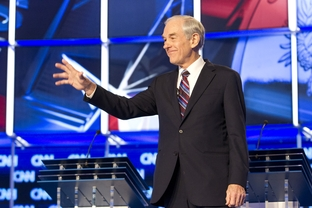 Texan Ron Paul waves while onstage at the CNN candidate debate in Charleston, S.C. on January 19, 2012.