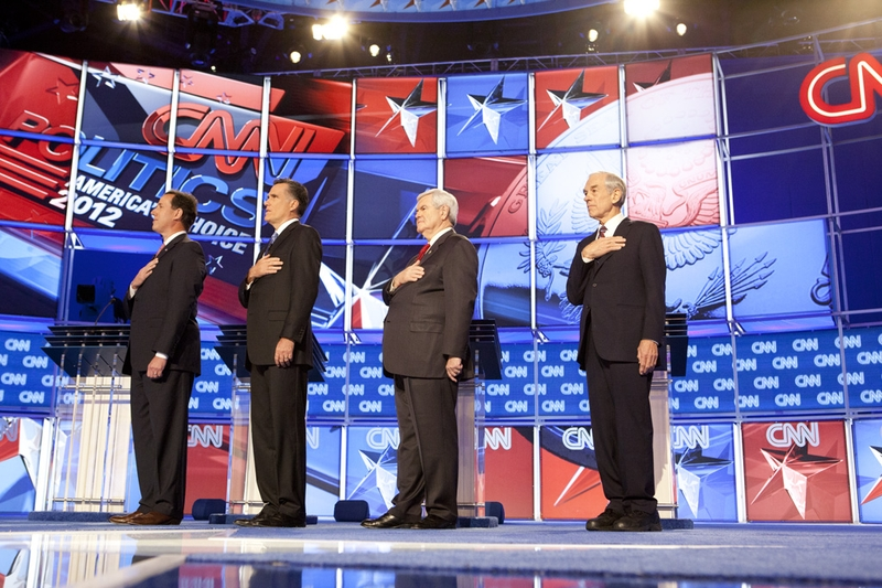 Republican candidates, left to right, Rick Santorum, Mitt Romney, Newt Gingrich and Ron Paul say the Pledge of Allegiance at the CNN Charleston debates on January 19, 2012.