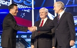 Republican candidates Mitt Romney, left, Newt Gingrich, center, and Ron Paul onstage at the CNN Charleston debate on January 19, 2012.