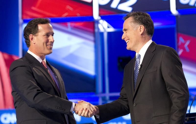 Rick Santorum, left, shakes hands with Republican Mitt Romney at the CNN Charleston debates on January 19, 2012.