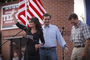 Republican primary candidate Ted Cruz, center, is joined on stage by Sarah Palin, left, and Senator Jim DeMint, right, at a rally in The Woodlands, Texas, on Friday July 27, 2012.