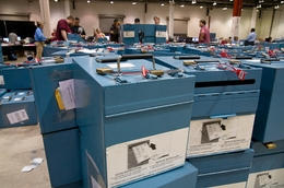 Paper-ballot boxes flood Reliant Center, where Harris County officials convened to count thousands of paper ballots.