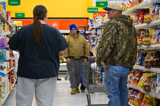 East Texas residents shop in a grocery store.