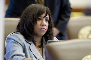 State Rep. Stefani Carter, R. Dallas,  listens to debate on the House floor on May 16, 2011.