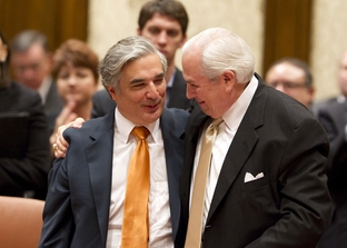 University of Texas System Chancellor Francisco Cigarroa (left), is congratulated by Gene Powell, chairman of the UT System Board of Regents, after the regents gave Cigarroa a vote of confidence on May 12, 2011.