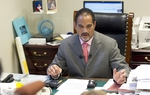 State Rep. Garnet Coleman, D-Houston, talks in his office about a letter sent to Comptroller Susan Combs regarding the state budget on May 26, 2011.