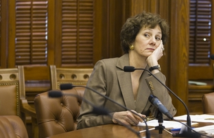 Texas Comptroller Susan Combs waits for Gov. Rick Perry at the meeting of the state's Cash Management Committee on July 19, 2011.