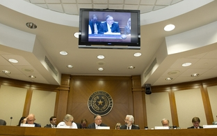 The Senate Business and Commerce Committee with Sen. John Carona (c), R-Dallas, votes to pass out the Texas Windstorm Insurance Association (TWIA) bill to the full Senate on June 22, 2011.