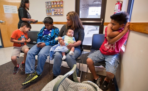 Rosario Espriella (center) waits for her appointment at the Edinburg, Texas Planned Parenthood clinic on Tuesday, February 14 with her children L to R:  Edgar, 6, Eduardo, 12, Diego, 2 months and Victor, 10.