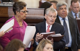 Two of the longest serving House members, State Rep. Senfronia Thompson (l), D-Houston, and State Rep. Tom Craddick, R-Midland, confer on April 26, 2011.