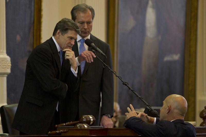 Gov. Rick Perry and Lt. Gov. David Dewhurst listen to Sen. John Whitmire, D-Houston, on Jan. 8, 2013, the opening day of the 83rd legislative session.