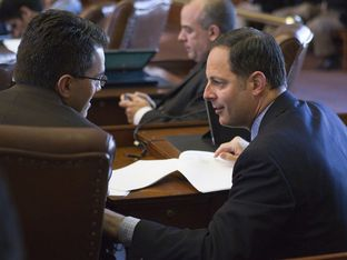 State Rep. Rafael Anchia, D-Dallas, speaks with fellow Rep. Mark Strama, D-Austin, after 2013 committee assignments are announced.