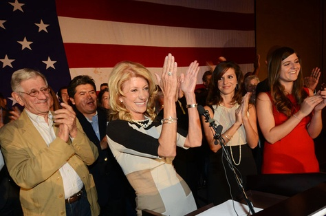 Wendy Davis, flanked by her father, Jerry Russell at left and her two daughters, at right, applauds her supporters during her victory speech at the Fort Worth Hilton on November 6, 2012.