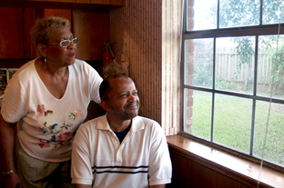 Scherry Levi with her mentally disabled nephew Deartis Preston in Preston's home in Bay City.