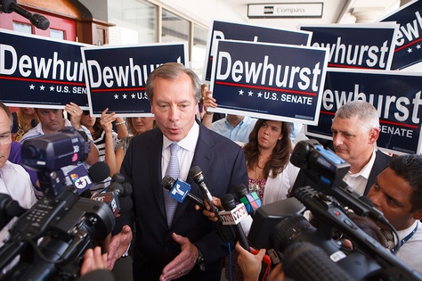 Lt. Gov. David Dewhurst talking with reporters while campaigning for U.S. Senate in Houston on July 31, 2012.
