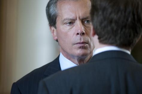 Lt. Governor David Dewhurst (l), talks with Sen. Dan Patrick on the floor of the Texas Senate on April 18, 2011.