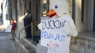 Someone dressed in a duck suit stands outside the Austin Club before U.S. Senate candidate David Dewhurst's appearance at a TribLive event on Nov. 17, 2011.