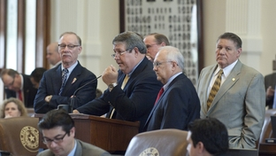 State Rep. Doug Miller (c, at mike)R-New Braunfels, speaks on SB341 a San Antonio water district bill as Jim Keffer (l), R-Granbury and Bill Callegari (r) R-Houston, listen on Saturday May 21, 2011.