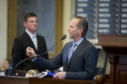 State Rep. Craig Eiland (r), D-Galveston, speaks against HB274 the lawsuit reform bill as Rep. Brandon Creighton, R-Conroe, listens on May 9, 2011.