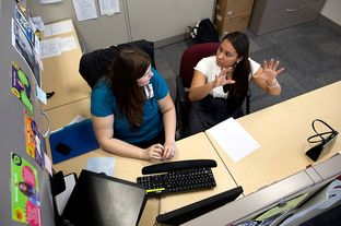Rachel Bristow, a caseworker for Goodwill's GED program, assists 22-year-old Anita Rodriguez, who received her GED in August 2011, with her financial aid application at the Goodwill Resource Center in Austin, Texas.