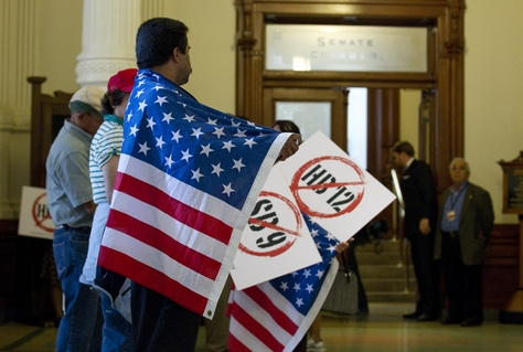 """Protesters with American flags line the hallway outside the Senate chamber protesting HB12 the so-called """"sanctuary cities"""" bill on May 25, 2011."""