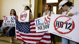 """Protesters block a rear entrance to Texas Governor Rick Perry's office on the second floor protesting HB12 the so-called """"sanctuary cities"""" bill winding its way through the Senate on May 25, 2011."""