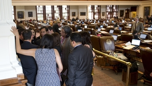 Democractic members huddle in the rear of the Texas House chamber while HB12 immigration bill is being negotiated on May 9, 2011.