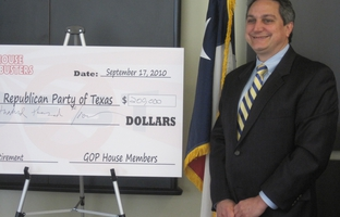 Steve Munisteri receives Debt Busters check.