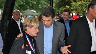 Perry talking to supporter while touring the Manchester NH Chili Festival