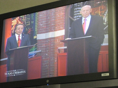 The Democratic candidates on screen at their primary debate.