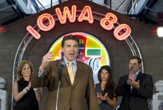 """Presidential candidate Rick Perry makes a speech at the Iowa 80 """"World's Largest Truck Stop"""" at Walcott, Iowa on August 16, 2011."""