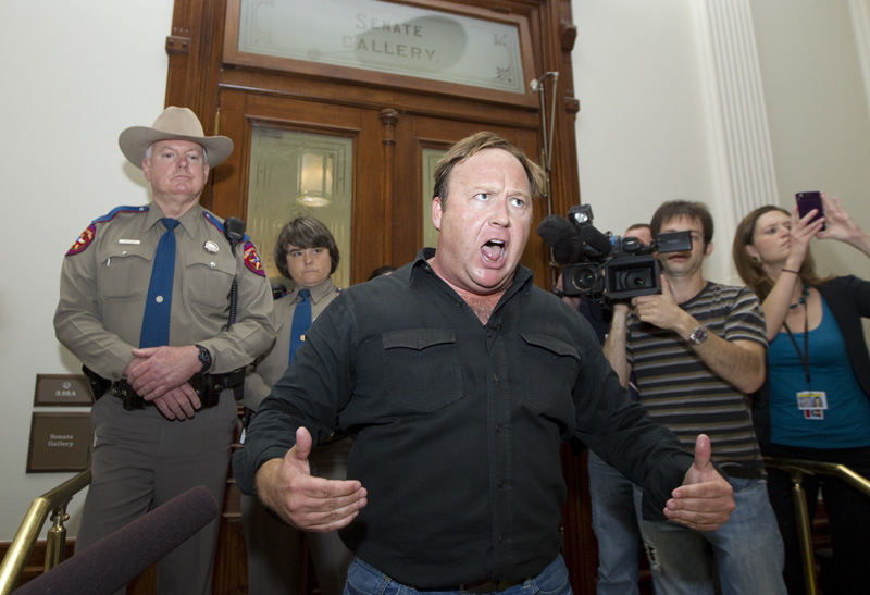 Talk show host and activist Alex Jones screams to the crowd outside the Senate gallery on May 25, 2011, after being denied entrance during a rowdy protest of House Bill 1937 which criminalizes invasive airport pat downs.