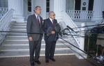 Diplomat Henry Kissinger (r) joins Texas Governor George W. Bush at the Governor's Mansion in July, 2000.