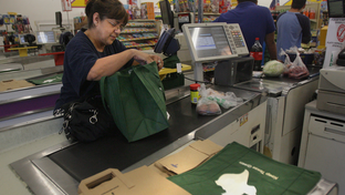 Brownsville resident Rosie Orozco bags her own groceries in a reusable bag after shopping at an A.V. Lopez grocery store. Orozco says she always carries reusable bags in her car.