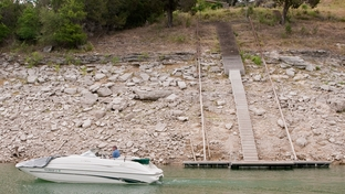 Residents of Lake Travis have extended staircases and moved docks further out to accommodate lower lake levels. Some say the declining levels are bringing down property values.