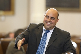 State Rep. Armando Martinez reaches to shake a colleague's hand after helping to temporarily derail HB112 voter ID legislation on March 21, 2011.