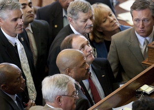 State Rep. Rob Eissler (c, top), R-The Woodlands, and State Rep. Borris Miles (c, bottom) wait for a ruling on HB400 point of order on April 26, 2011.