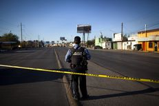 "A municipal police officer at a crime scene in Ciudad Juarez, Mexico. The municipal police force was recently ""purged"" under the new chief of police Julien Leyzaola."