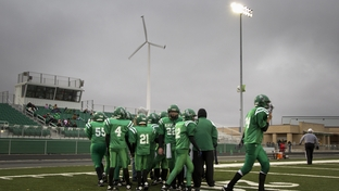 A junior high 6-man football game in Blackwell ISD. The on-site wind turbine can produce up to 40 percent of the school's electricity needs.