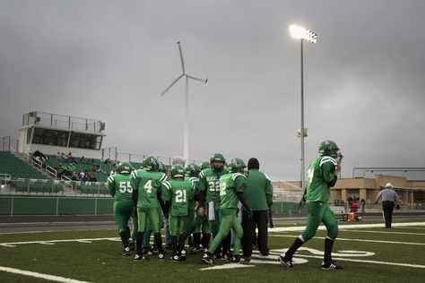 A junior high 6-man football game in Blackwell ISD in their new $3 million football stadium, which wind money helped pay for. The on-site wind turbine can produce up to 40 percent of the school's electricity needs.