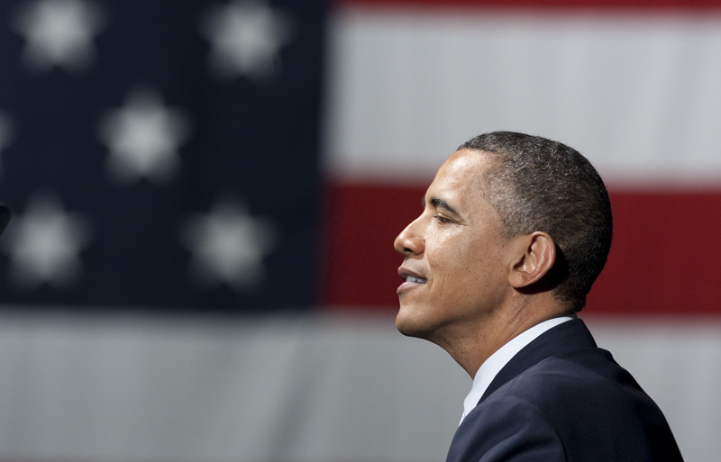 President Barack Obama pauses during a speech to supporters at the Austin City Limits Live venue on March 10, 2011.