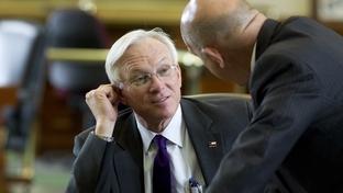 Sen. Steve Ogden (l), R-Bryan, talks with Sen. John Whitmire, D-Houston, on the Senate floor on March 29, 2011