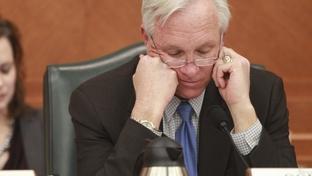 Senate Finance Chairman Steve Ogden (R-Bryan) looks grim while he peruses Senate Bill 1 on January 31, 2011.