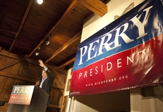 Gov. Rick Perry delivers a campaign speech to a crowd in Orange City, Iowa, on Oct. 8, 2011.
