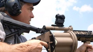 Gov. Perry fires an M-32 grenade launcher.