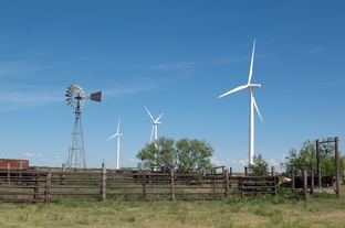 New turbines tower over an old windmill at the Whirlwind wind