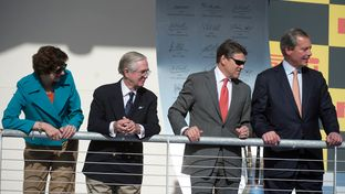 Awards stand of the Formula One Grand Prix in Austin, left to right, Comptroller Susan Combs, Nick Craw of FIA, Governor Rick Perry and Lt. Governor David Dewhurst.