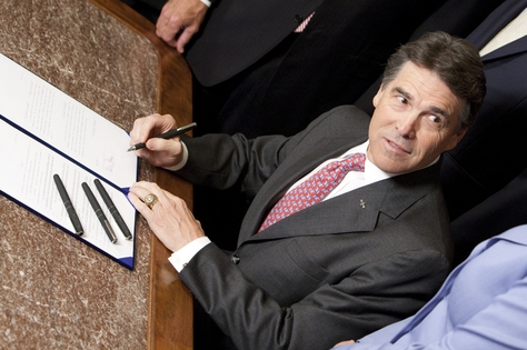 Gov. Rick Perry ceremonially signs the Voter ID on May 27, 2011.
