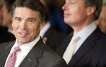 Gov. Rick Perry and Lt. Gov. David Dewhurst at the voter ID bill signing on May 27, 2011.