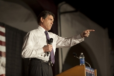 Gov. Rick Perry takes a question at the Black Hawk County Republican Party's Lincoln Day Dinner in Waterloo, Iowa, on Aug. 14, 2011.